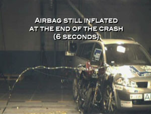 holding trophy airbag crash 6